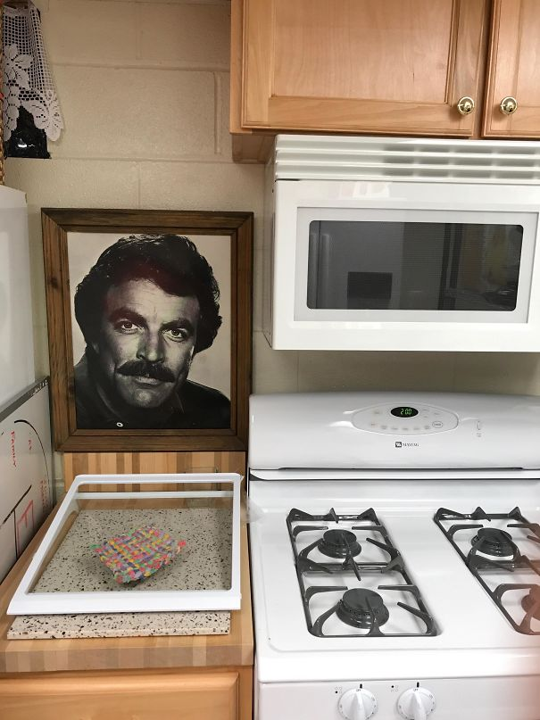This Framed Picture Of Tom Selleck In My Mother-In-Law's Basement Kitchen