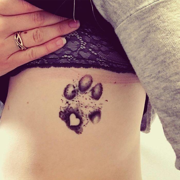 The Paws Of The Dogs Are Being Tattooed On Their Owners And The Result Is Adorable