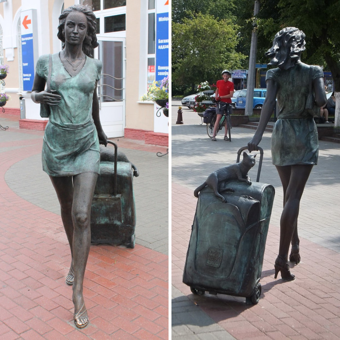 Sculpture Of Woman And Kitten Arriving On A Trip Leaves Its Inhabitants In Love