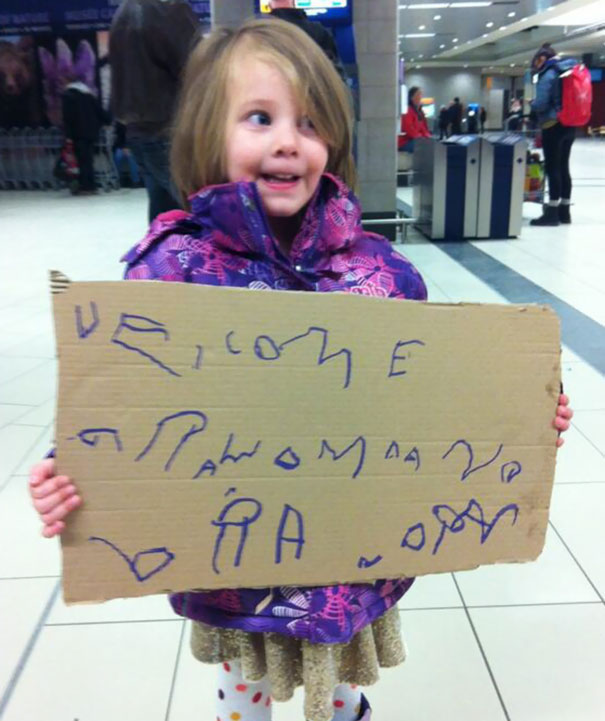 Kid Made A Sign For Grandma And Grandpa's Arrival. It's Getting A Lot Of Smiles At The Airport While We Wait