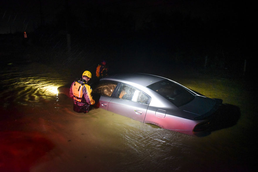 Rescue Staff From The Municipal Emergency Management Agency Investigate An Empty Flooded Car During The Passage Of Hurricane Irma Through The Northeastern Part Of The Island In Fajardo, Puerto Rico