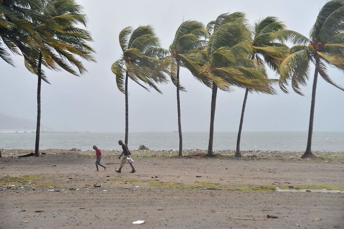 Haitian People Walk Through The Wind And Rain On A Beach, In Cap-haitien As Hurricane Irma Approaches