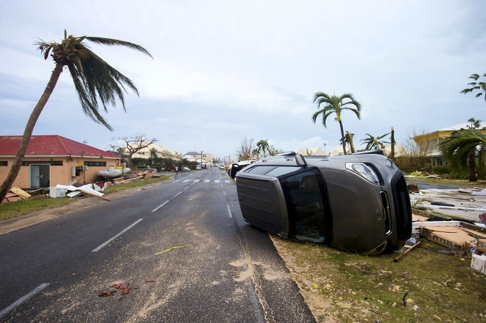 A Car Is Left Turned Onto Its Side From Hurricane Winds In Marigot, Saint Martin, On Wednesday