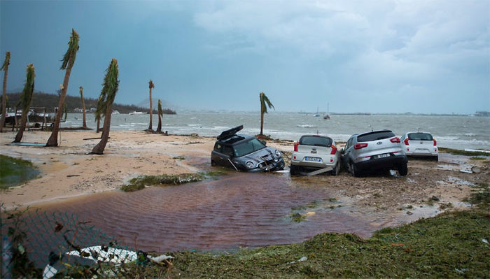 Damaged Cars Are Seen On A St. Martin Beach