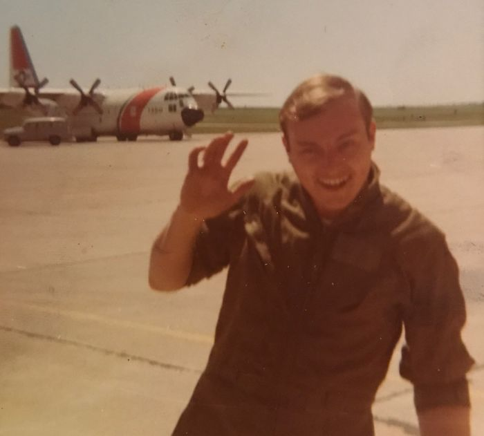 My Dad Goofing Around On The Tarmac In Front Of The C130 He Crewed In The Uscg In The 70s.