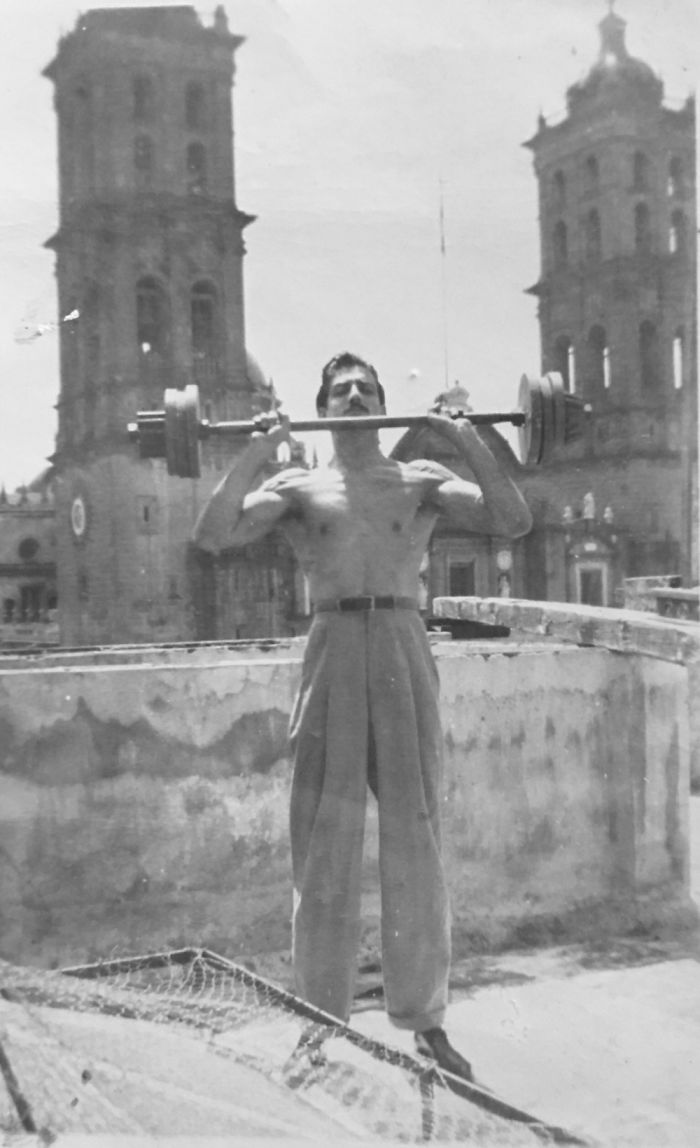 My Grand Dad Lifting Weights On His Roof Top At The Age Of 23.