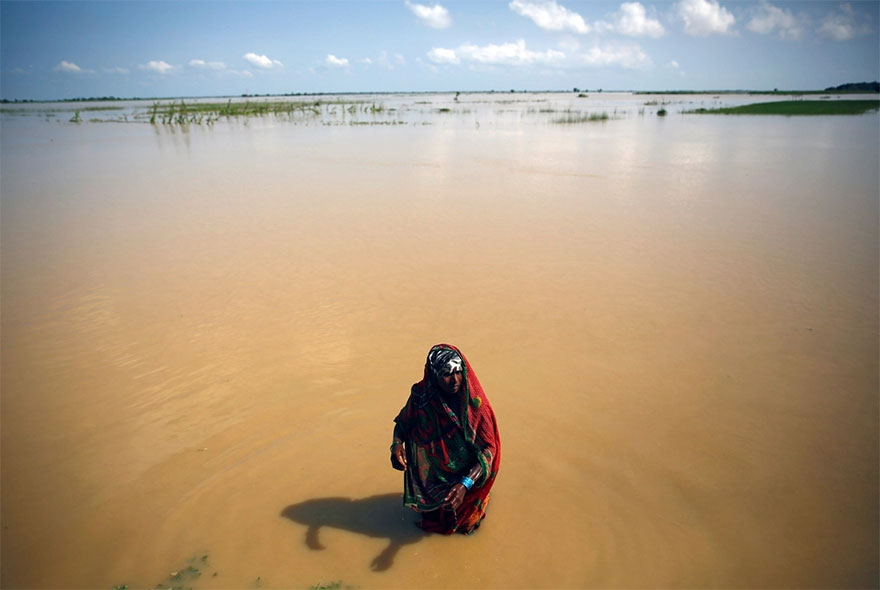 A Flood Victim Washes Herself In Saptari District, Nepal