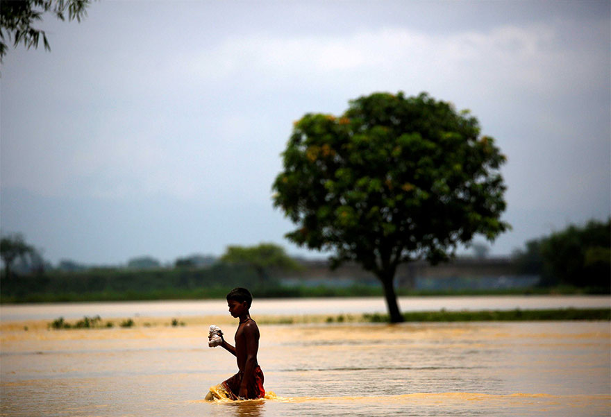 A Boy Walks Along Flood Waters In Saptari District, Nepal