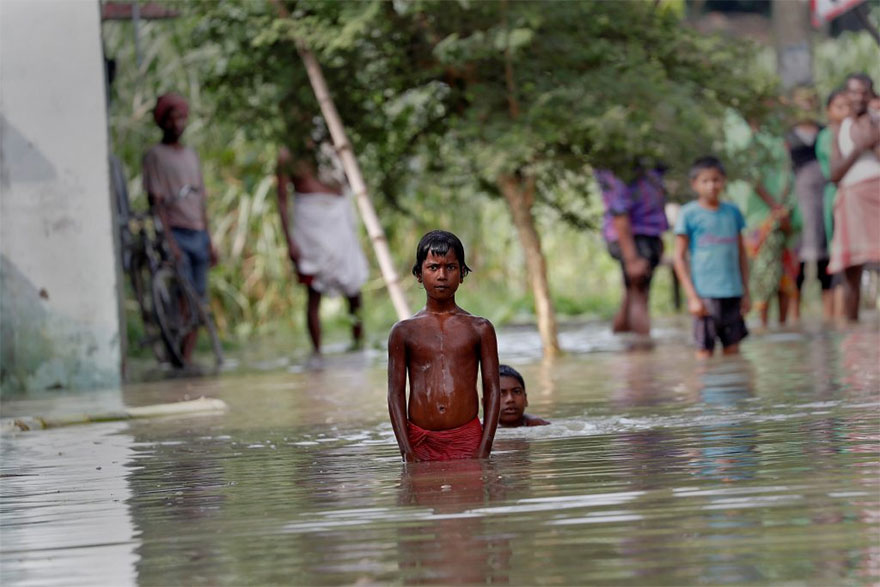 People Wait To Be Rescued From A Flooded Village In The Eastern State Of Bihar, India