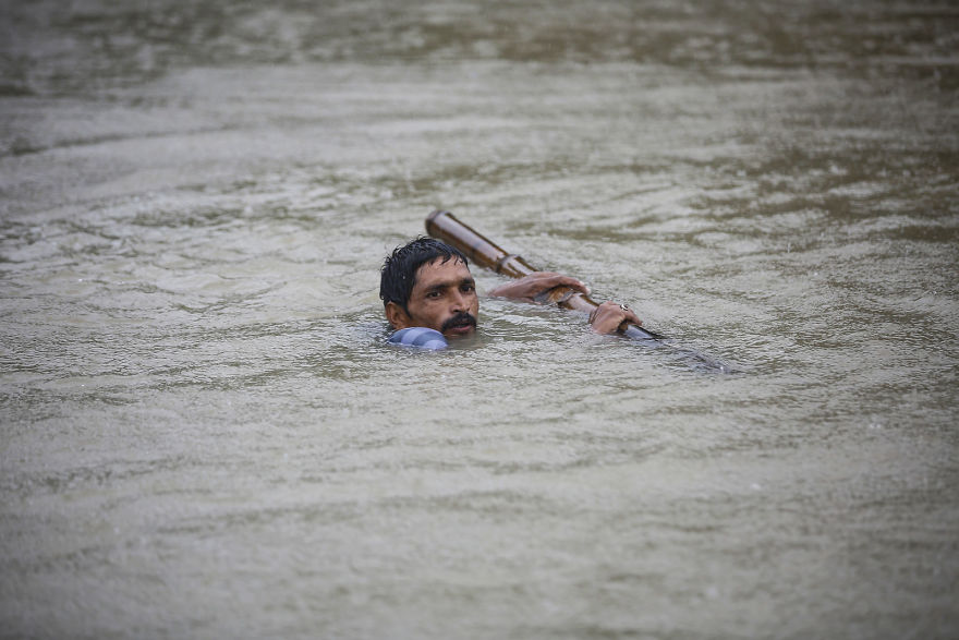 A Nepali Man Tries To Cross Flood Water At Topa Village In Saptari District