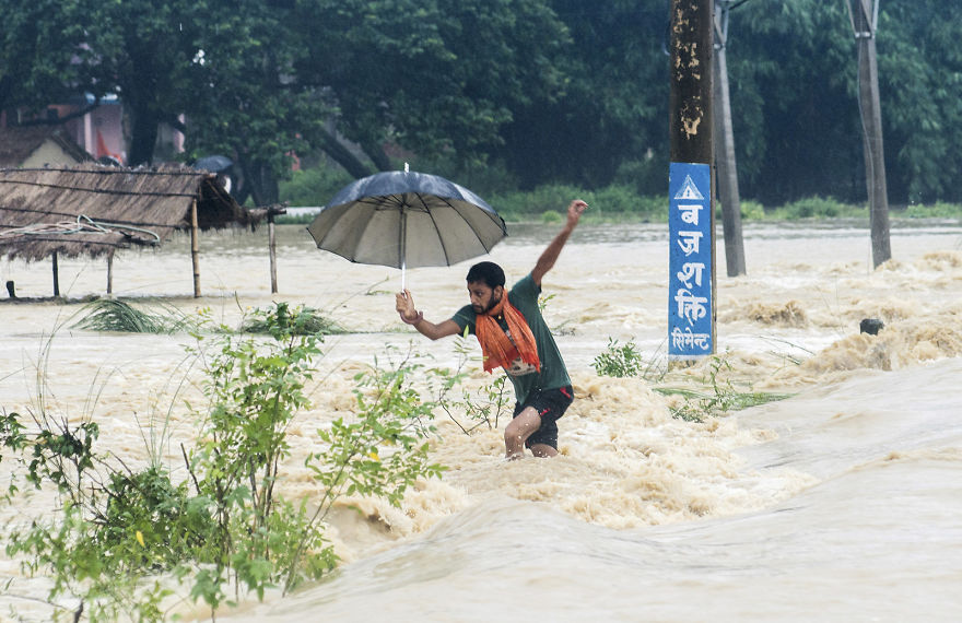 A Man Tries To Cross A Flooded Street In Birgunj, Nepal