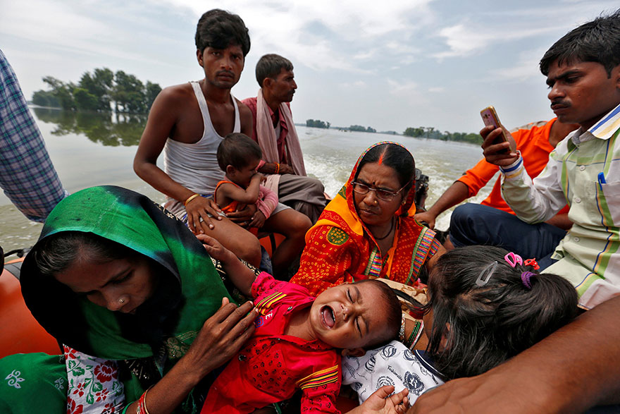 A Baby Suffering From Dehydration Cries After Being Rescued From A Flooded Village In The Eastern State Of Bihar, India