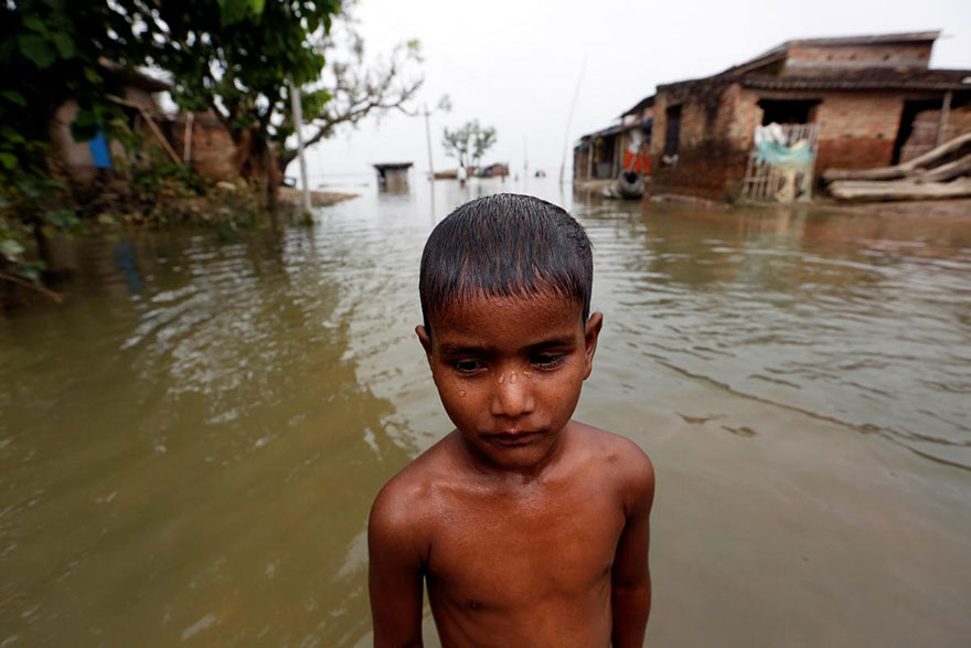 A Boy Is Pictured In A Flooded Village In Motihari, Bihar State, India