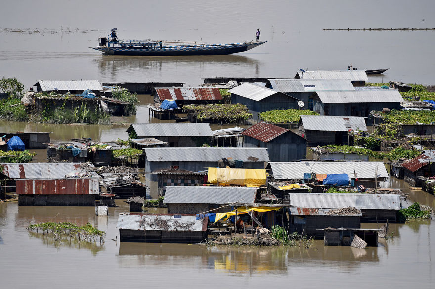 Houses Are Partially Submerged By Floods In Morigaon District In Assam