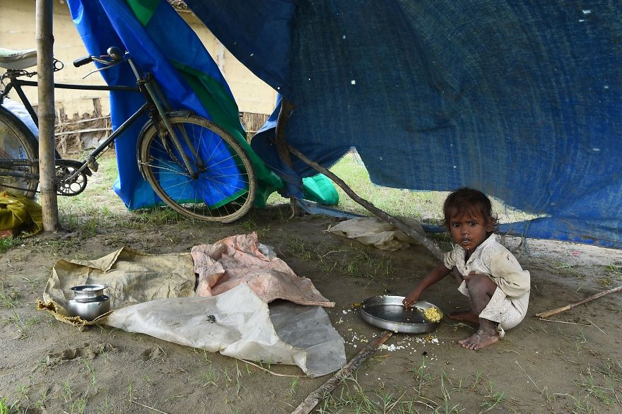 A Child Eats At A Makeshift Flood Shelter In Gaur, About 200 Km South Of Kathmandu, The Nepali Capital