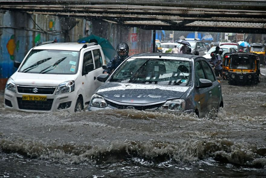 A Car Drives Past As It Rains At Andheri Subway In Mumbai, India