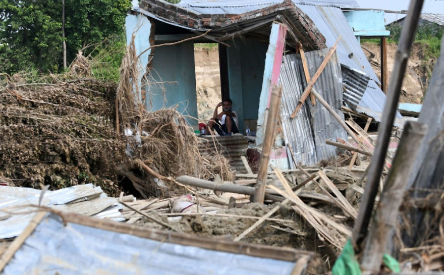 A Man Rests In His House Damaged By Flooding Some 250 Kilometers From Nepal's Capital Kathmandu