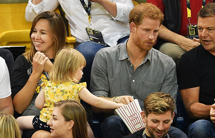 Toddler Keeps Stealing Prince Harry's Popcorn Until He Finally Notices, And His Reaction Says It All