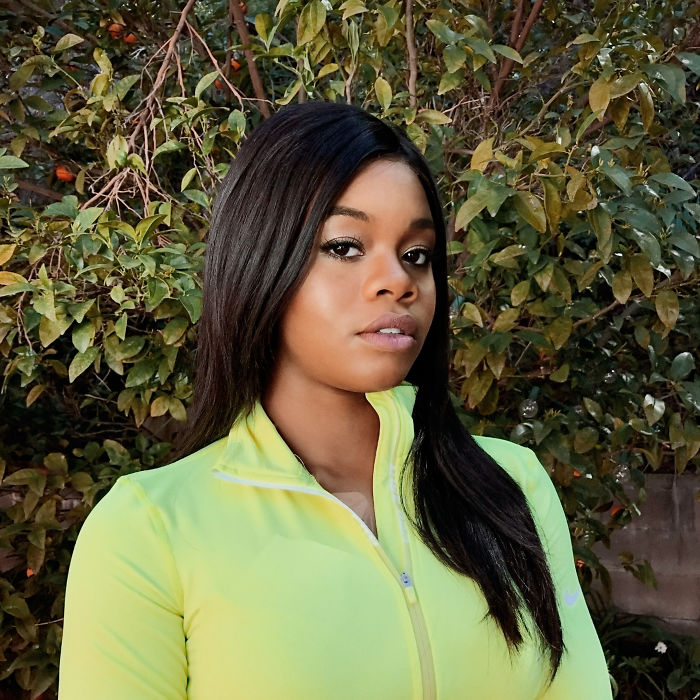 Gabby Douglas - First American Gymnast To Win Solo And Team All-Around Gold Medals At One Olympics