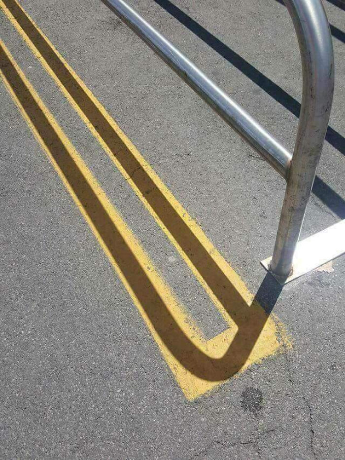 Shadow Fits On The Parking Lines Perfectly