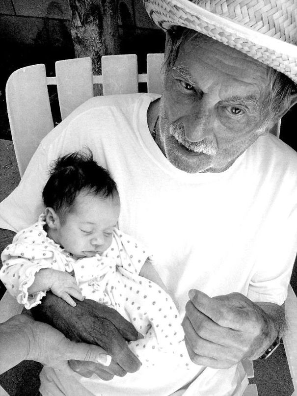Passing The Torch. Great-Grandfather Meeting His Great-Granddaughter