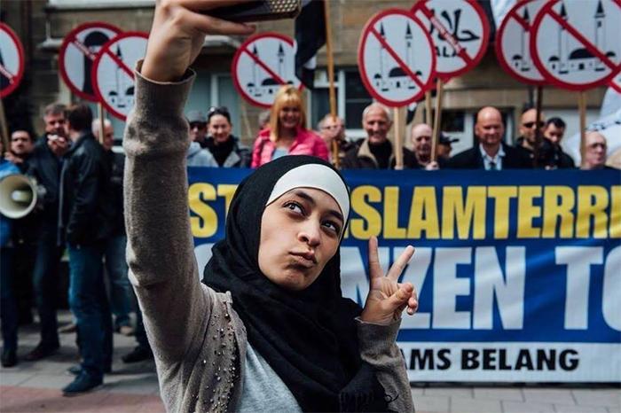 Zakia Belkhiri Takes A Selfie At An Anti-Muslim Demonstration In Antwerp, Belgium 2016
