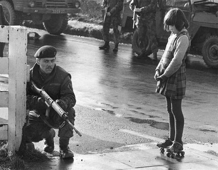Young Girl With Roller Skates Shows A Soldier In Derry She Isn't Scared, Northern Ireland, 1969
