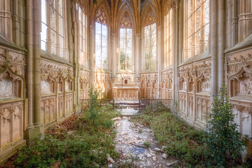 Abandoned Chapel With Plants On The Floor