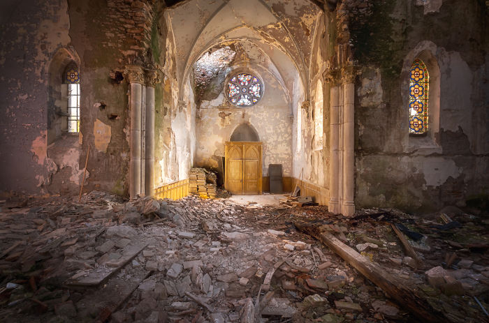Abandoned Church With Debris On The Floor