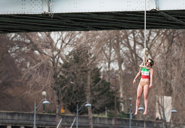 A Femen Activist, Sarah Constantin, Is Hanged From A Noose-Like Rope From A Paris Bridge To Call Attention To The Large Number Of Executions In Iran. Paris, 28 January 2016