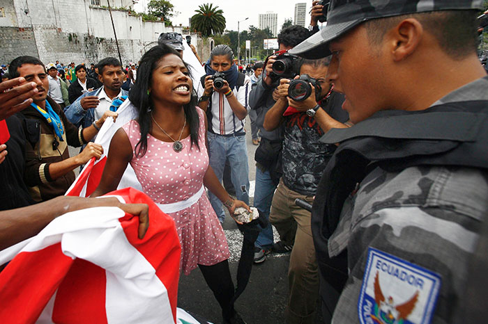 An Afro-Ecuadorean Woman Argues With Police Guarding A Fence In Front Of The National Assembly In Quito. In Protest Of A Proposed Water Privatization Law That Could Impact The Country's Indigenous Population, 5 May 2010