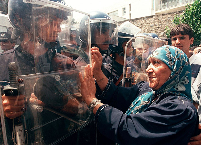 A Woman Gestures To Riot Policemen During A Protest Organized By The Rally For Culture And Democracy (Rcd), Algiers, 02 July