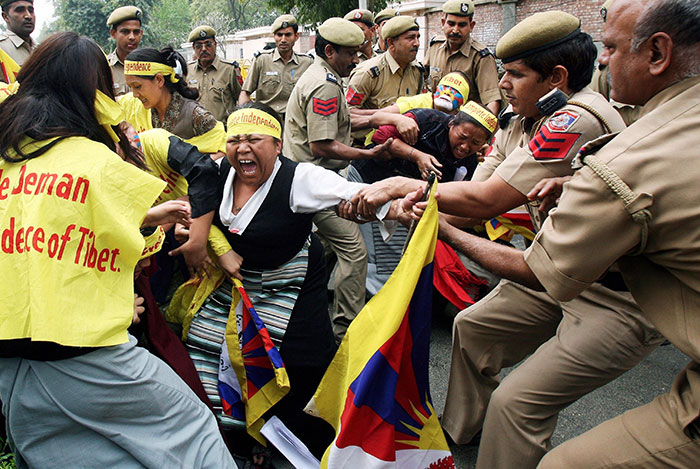 Indian Policemen Restrain A Tibetan Woman During A Demonstration At The Chinese Embassy. On The Occasion Of The Tibetan Women's Uprising Day, New Delhi, 12 March 2008