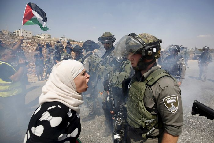 A Palestinian Woman Argues With An Israeli Border Policeman During A Protest Against Jewish Settlements In The West Bank Village Of Nabi Saleh
