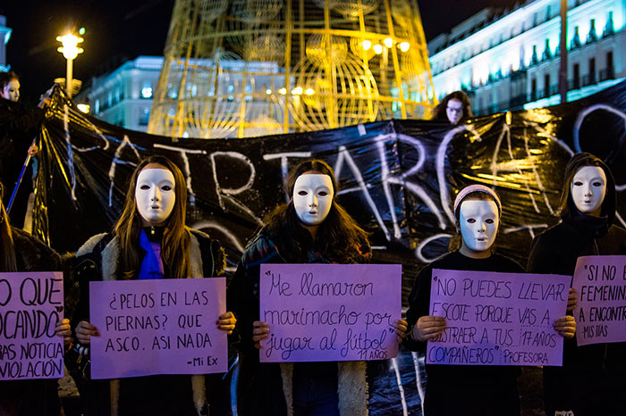 Masked Women Protesting Against Gender Violence During A Demonstration In Madrid For The International Day Against Gender Violence, 25 November 2015