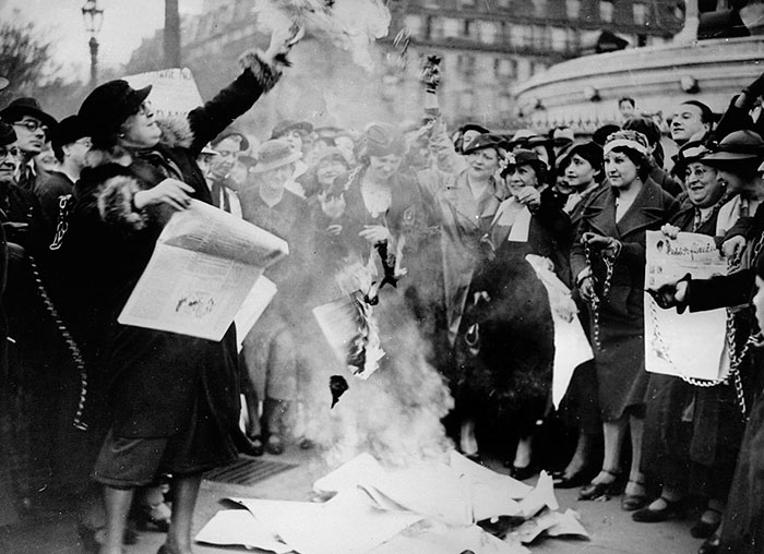 Feminists Are Burning Some Election Posters To Fight For Women's Suffrage. Photograph. Paris, France, 12 May 1935