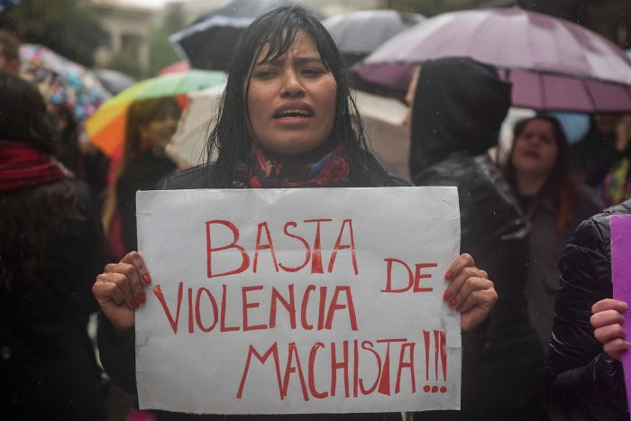 """A Woman In Buenos Aires Protests With A Sign That Says """"Stop Sexist Violence"""""""
