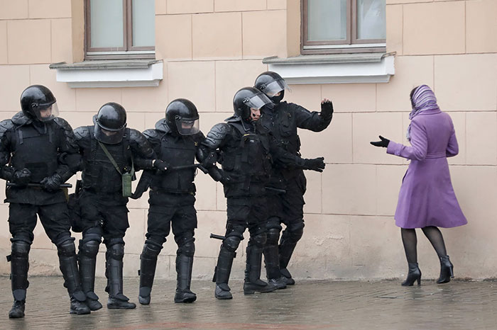 A Woman Argues With Belarus Police Officers Blocking A Street During An Opposition Rally In Minsk, Belarus As Hundreds Of People Were Arrested Over Protests Against Authoritarian President Alexander Lukashenko, 25 March 2017