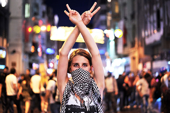 An Anti Government Protester Flashes A Victory Sign During The Clashes Between Protesters And Riot Police On Taksim Square In Istanbul, 22 June 2013