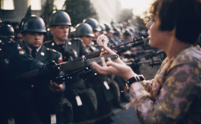 Young Pacifist Jane Rose Kasmir Planting A Flower On The Bayonets Of Guards At The Pentagon During A Protest Against The Vietnam War, 21 October 1967