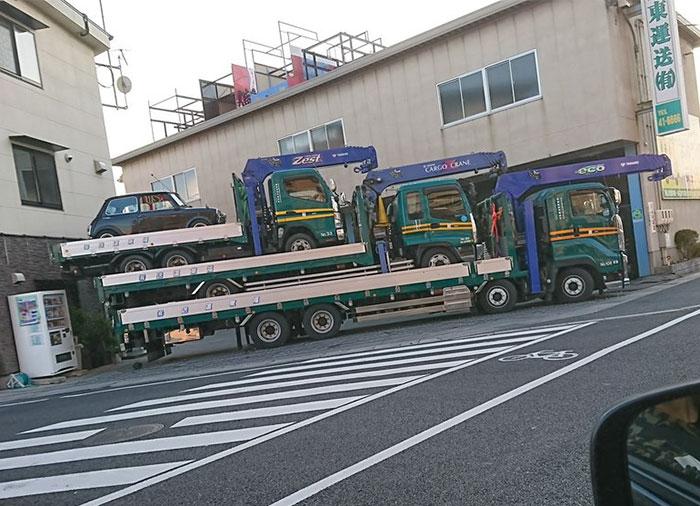 Three Tow Trucks And A Mini