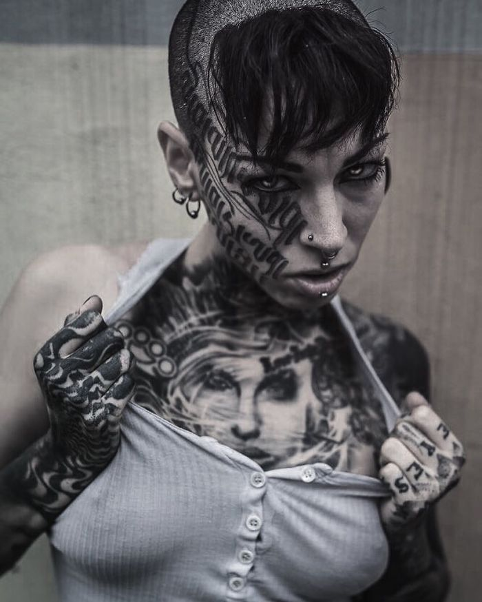 Tattoo Artist Gets Accused Of Racism For Tattooing Her Entire Body In Black