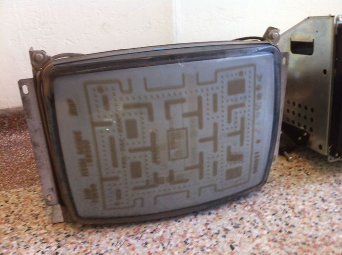 An Old CRT TV Screen That Has Seen A Lot Of Pacman