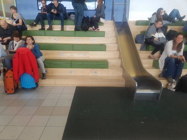 This Airport Waiting Area Has A Slide
