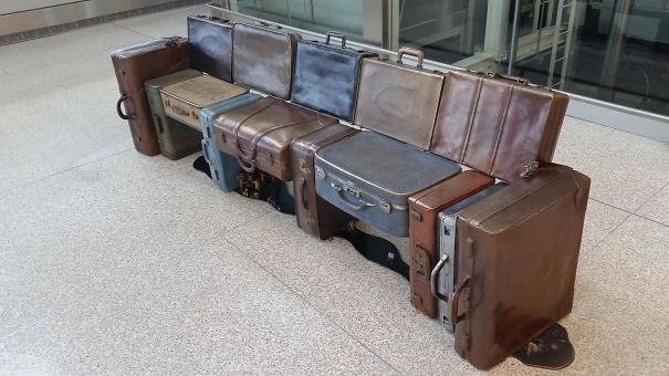 Luggage Turned Into A Place To Sit At The Airport
