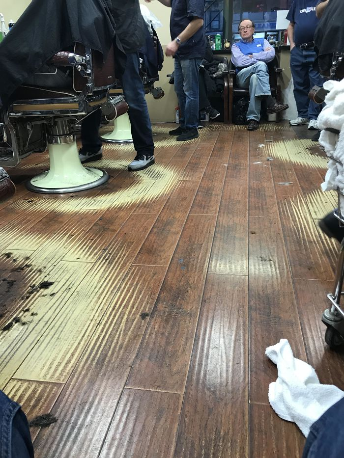 The Way The Floor Has Faded In Near Perfect Semi-Circles At This Barber Shop