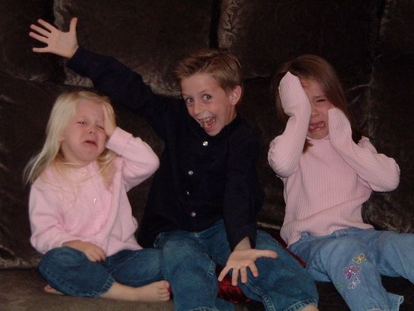 When I Was 7, My Mom Had Us Take Christmas Card Pictures. My Sisters Wouldn't Stop Fighting, So I Did What Older Brothers Do Best