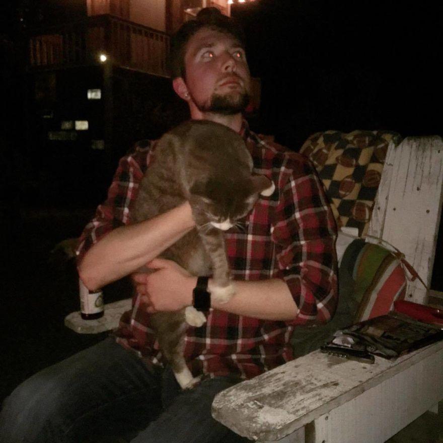 Man Cuddles Cats On Instagram