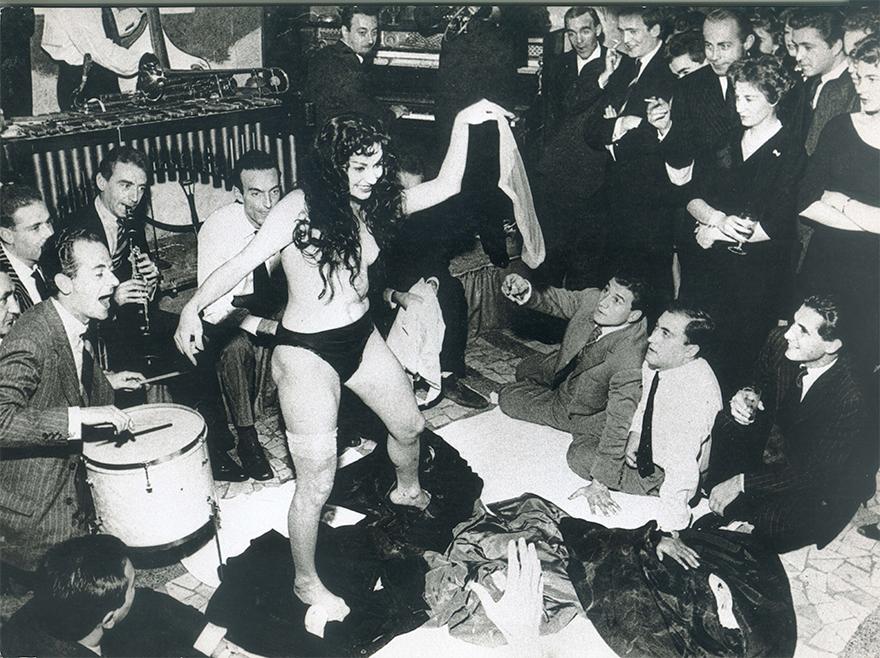 """Aiché Nanà's Striptease At Rugantino's Restaurant, Rome 1958. Aiché Nanà And Tazio Secchiaroli, Whom Took The Picture, Were Both Fellini's Inspirations For The Film """"La Dolce Vita."""" The Film's Character Paparazzo, Inspired By Secchiaroli, Is The Origin Of The Word Paparazzi"""