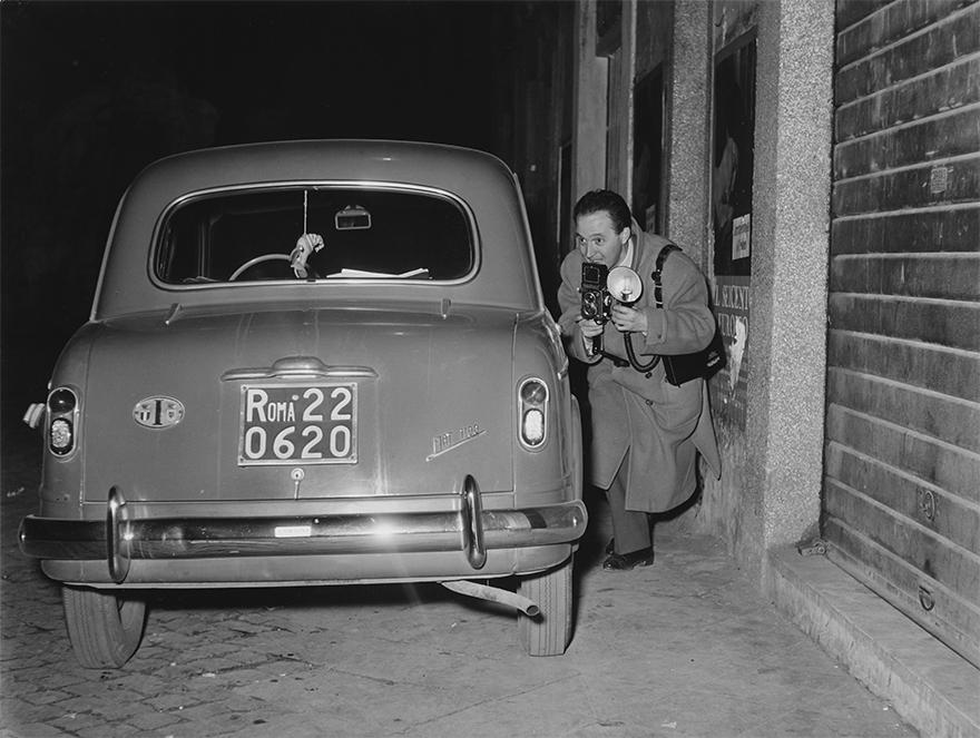 Photojournalist Tazio Secchiaroli Hides Armed With His Camera. Rome, 1958